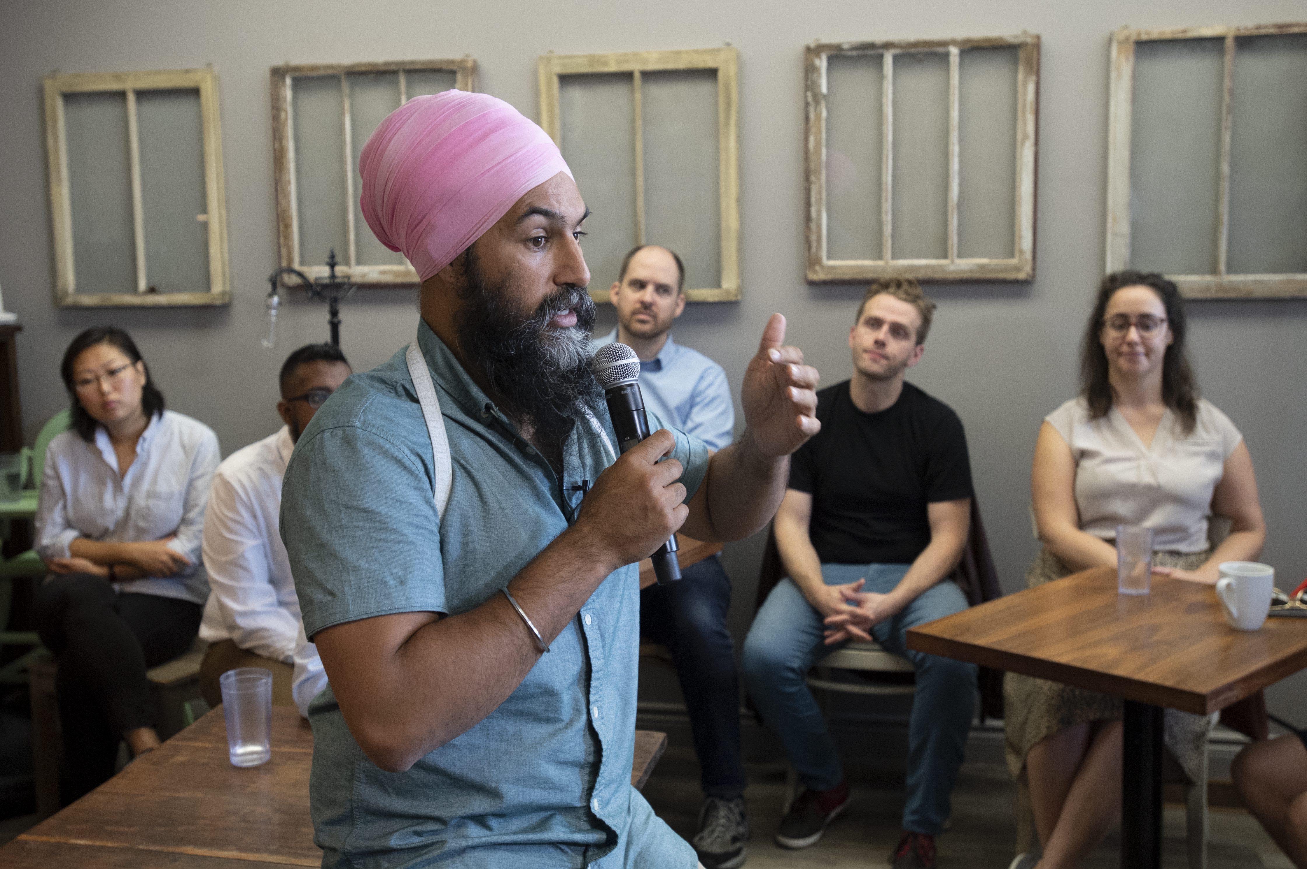 Canada's Trudeau pledges assault rifle ban, pivots campaign amid blackface scandal