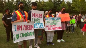 Thousands walk in multi-faith march to mourn loss of Muslim family